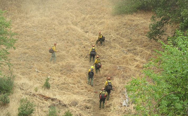 This is a photo of the Yosemite National Park fire crew putting in a hand line over Pigeon Ridge near El Portal Friday afternoon. There are over 2,800 personnel from several different states and agencies working on the Ferguson Fire that has grown to 27,000 acres. (Courtesy Yosemite National Park)