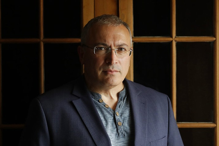 Russian opposition figure Mikhail Khodorkovsky, the former owner of the Yukos Oil Company, poses for a photograph after being interviewed by The Associated Press in London, Tuesday, July 24, 2018. Khodorkovsky's London-based investigative unit, the Dossier Center, is compiling profiles of Russians it accuses of benefiting from corruption with an eye toward their eventual prosecution. (AP Photo/Matt Dunham)