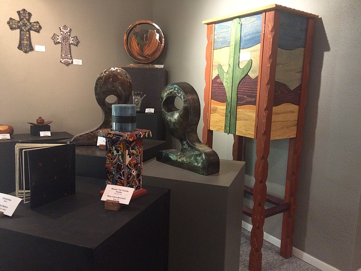 Just some of the artwork found in the Mountain Artists Guild gallery in Prescott. The Guild is having an open house from 1 to 8 p.m. Friday, July 27. (Jason Wheeler/Courier)