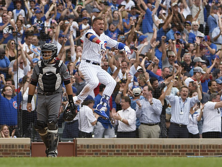 Chicago Cubs' Albert Almora Jr. (5) celebrates after Anthony Rizzo (44) hit a game-winning home run against the Arizona Diamondbacks during the ninth inning of a baseball game Thursday, July 26, 2018, in Chicago. The Cubs won 7-6. (David Banks/AP)