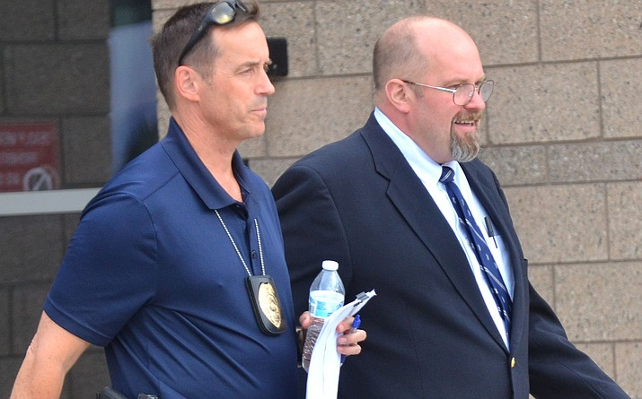 Amid safety concerns, defendant Thomas J. Chantry is escorted to his vehicle by law enforcement following Tuesday's proceedings in his molestation trial in Yavapai County Superior Court. VVN/Vyto Starinakas