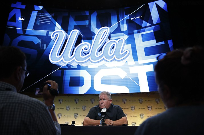 UCLA  coach Chip Kelly talks to reporters at the Pac-12 Conference NCAA college football media day in Los Angeles, Wednesday, July 25, 2018. (Jae C. Hong/AP)