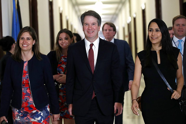 Supreme Court nominee Judge Brett Kavanaugh, center, arrives for a meeting with Sen. Jim Inhofe, R-Okla., Thursday, July 26, 2018, on Capitol Hill in Washington. (AP Photo/Jacquelyn Martin)