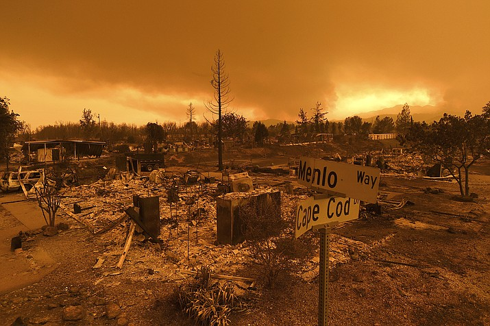 Homes leveled by the Carr Fire line the Lake Keswick Estates area of Redding, Calif., on Friday, July 27, 2018. (AP Photo/Noah Berger)