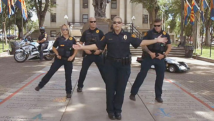 Prescott Police officers, led by Deputy Chief Amy Bonney, sing and dance in a video as part of the #LipSyncChallenge that is sweeping the nation. (Screen capture via Facebook video)