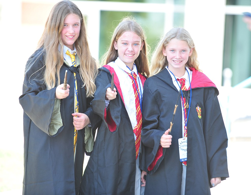 Alice Nyman, Sienna Judy and Ariel Laird, Hogwart students from Harry Potter at the Fandomania Comic Con event Saturday, July 28, 2018 in and around the Prescott Valley Library. (Les Stukenberg/Courier)