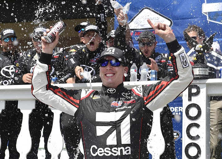 Kyle Busch celebrates in Victory Lane after winning a NASCAR Truck Series auto race, Saturday, July 28, 2018, in Long Pond, Pa. (AP Photo/Derik Hamilton)