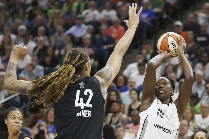 Team Candace Parker's Chelsea Gray, right, lines up a shot against Team Delle Donne's Brittney Griner, left, in the first half of the WNBA All-Star basketball game Saturday, July 28, 2018 in Minneapolis. (Stacy Bengs/AP)