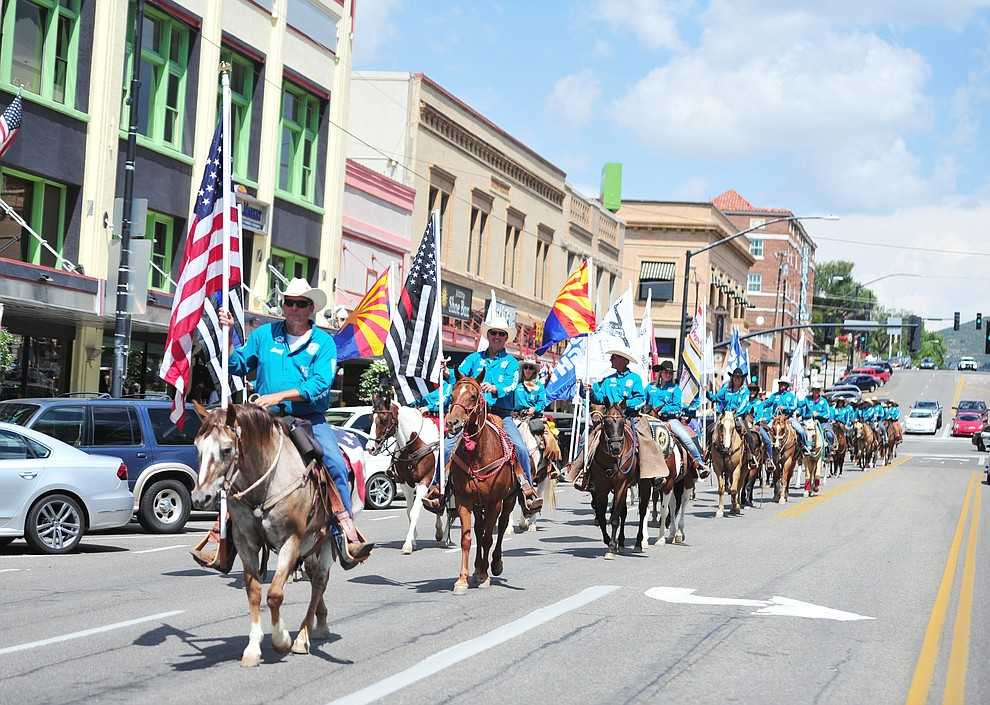 Almost 100 horseback riders ride along Gurley Street as part of the 13th annual Whiskey Row Shoout and National Day of the Cowboy in Prescott Saturday, July 28, 2018. (Les Stukenberg/Courier)