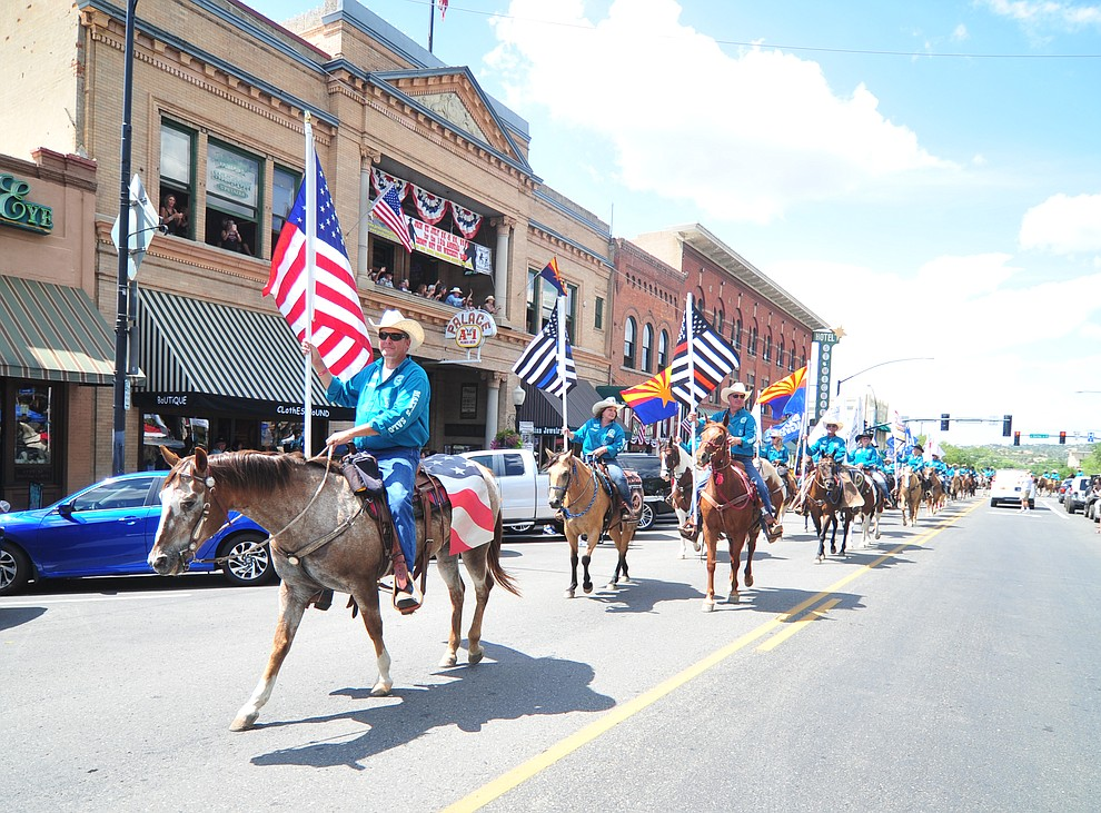 Almost 100 horseback riders ride along Motezuma Street as part of the 13th annual Whiskey Row Shoout and National Day of the Cowboy in Prescott Saturday, July 28, 2018. (Les Stukenberg/Courier)
