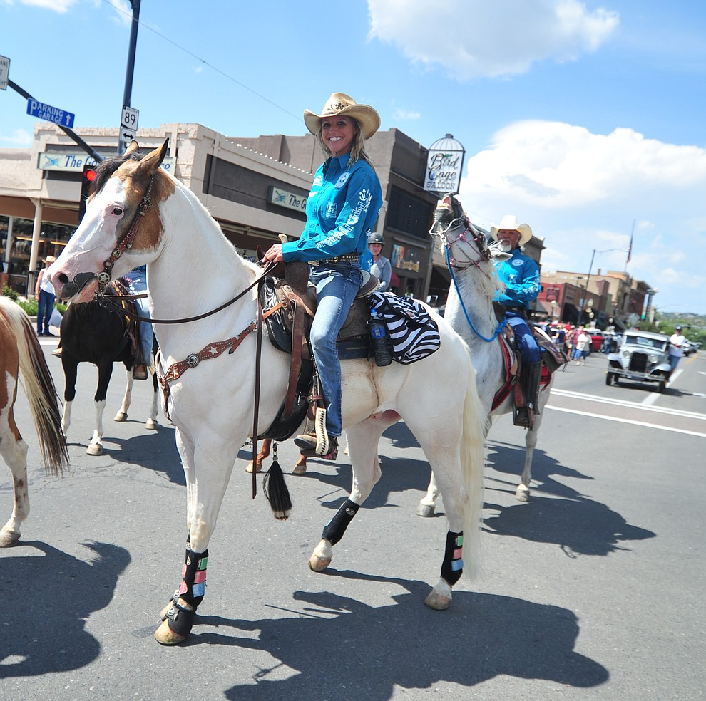 Kimberly Harmon and almost 100 horseback riders ride along Motezuma Street as part of the 13th annual Whiskey Row Shoout and National Day of the Cowboy in Prescott Saturday, July 28, 2018. (Les Stukenberg/Courier)