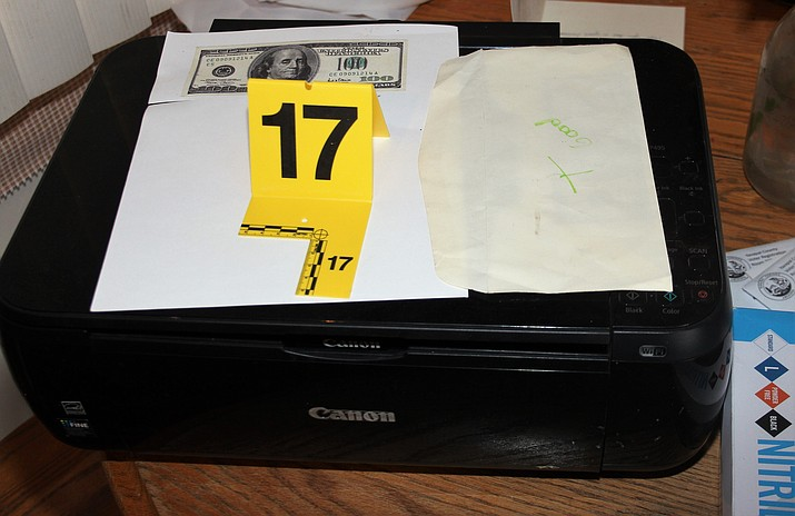 In a Cornville-based counterfeit money case handled by the Yavapai County Sheriff's Office in May, detectives seized several inkjet printers and numerous chemicals used to wash U.S. currency. Detectives also found a large amount of counterfeit bills in $20, $50 and $100 denominations. Some of the bills were in the process of counterfeiting. (Yavapai County Sheriff's Office/Courtesy)