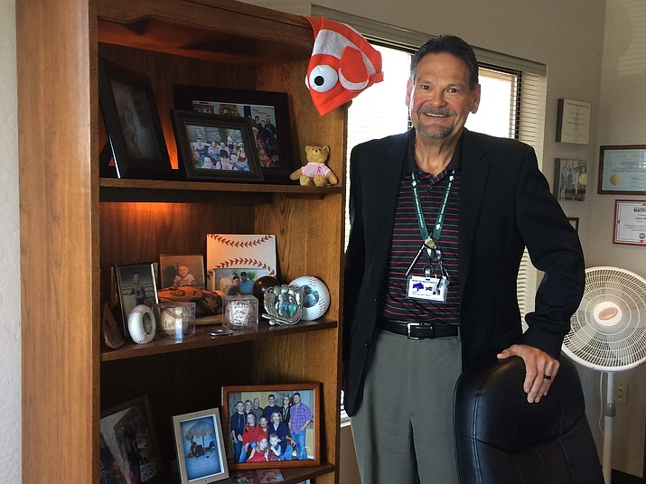 West Yavapai Guidance Clinic Executive Director Larry Green in his office. On one bookcase, he has a Nemo-style fish puppet that speaks to the FISH! Philosophy of leadership: play – be creative and open to new ideas; make their day – find simple ways to make a memorable impression on one's team members; choose our attitude – take responsibility for how one responds to issues and reflect on how that response impacts the team; be there – be emotionally present for team as that offers message of respect that enhances communication and strengthens relationships. (Nanci Hutson/Courier)