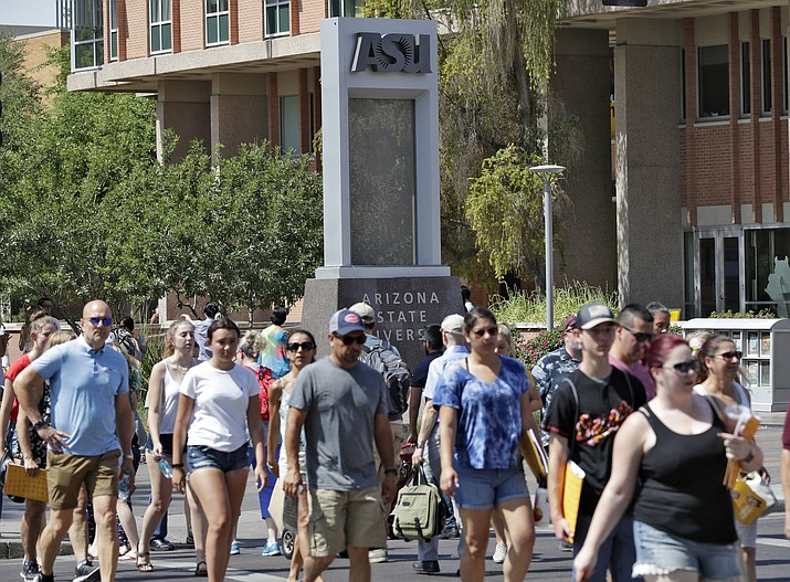 Pedestrians cross University Avenue on the campus of Arizona State University, Wednesday in Tempe. Californians, including many turned away by public universities in their own state, are flocking to four-year state and private universities in neighboring Arizona. (/Matt York/AP Photo)