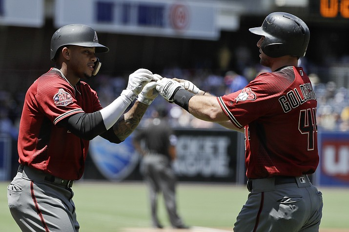Arizona Diamondbacks' Paul Goldschmidt, right, is greeted by teammate Ketel Marte, left, after hitting a two-run home run during the first inning of a baseball game Sunday, July 29, 2018, in San Diego. (Gregory Bull/AP Photo)