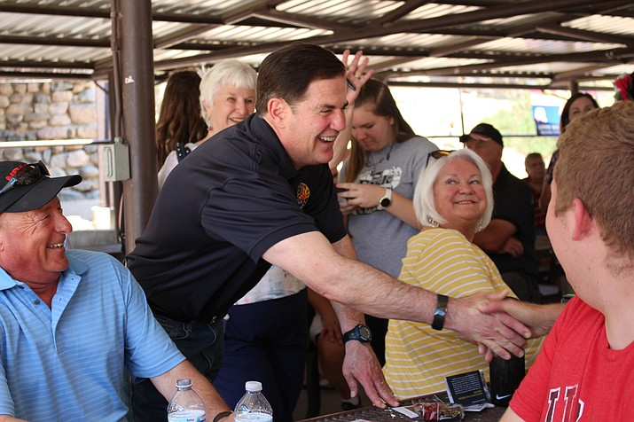 Gov. Doug Ducey visited the Kingman Daily Miner to talk about the education, opioid crisis, and the Arizona economy after meeting and greeting people at the Mohave County Republican Picnic Saturday. (Photo by Vanessa Espinoza/Daily Miner)