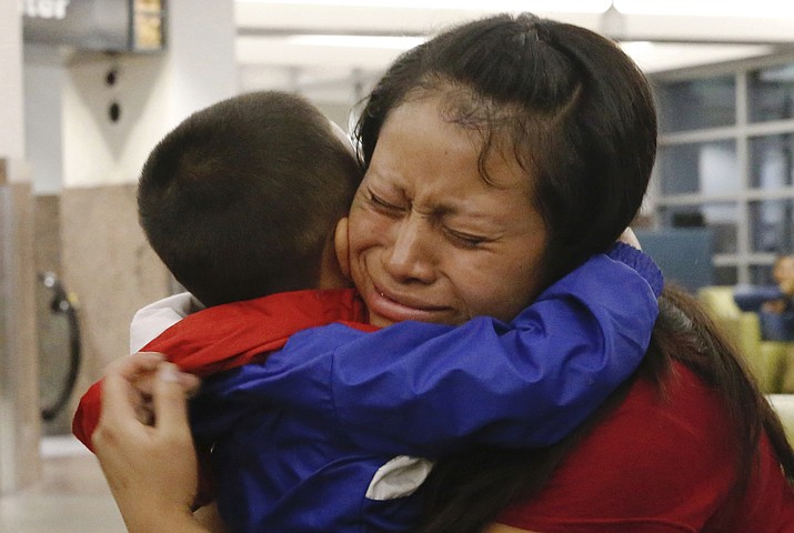 Maria holds her 4-year-old son Franco after he arrived at the El Paso International Airport Thursday in El Paso, Texas. Ruben R. Ramirez/(The El Paso Times via AP)