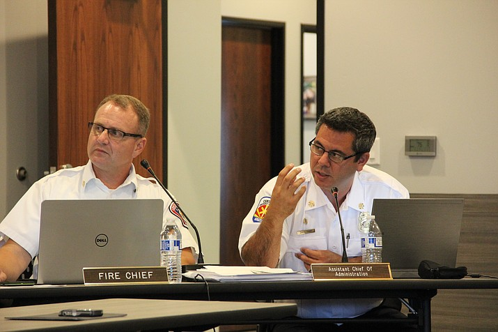 David Tharp, assistant chief of administration for the Central Arizona Fire and Medical Authority, right, speaks to the organization's board of directors about financial auditing Monday, July 23. Sitting next to Tharp is CAFMA Fire Chief Scott Freitag. (Max Efrein/Daily Courier)
