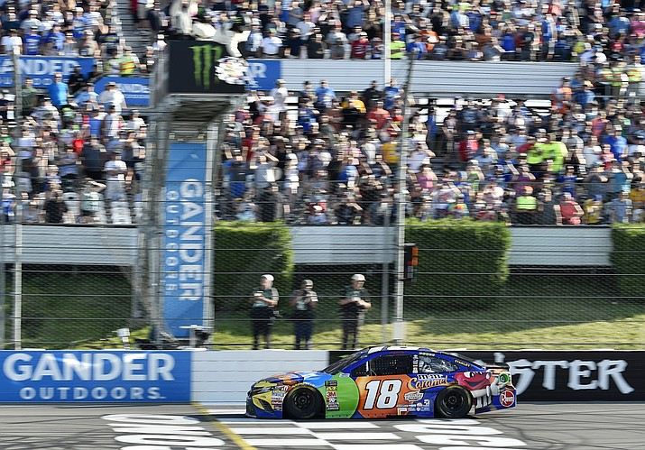 Kyle Busch crosses the finish line to win a NASCAR Cup Series auto race, Sunday, July 29, 2018, in Long Pond, Pa. (Derik Hamilton/AP Photo)