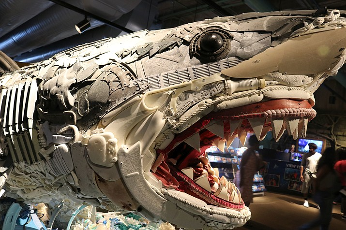 "In this photo taken July 26, 2018, the front third of ""Greta the Great White Shark,"" one of six huge sea-life sculptures from a project called Washed Ashore: Art to Save the Sea, is viewed at the Audubon Aquarium of the Americas in New Orleans. (AP Photo/Janet McConnaughey)"