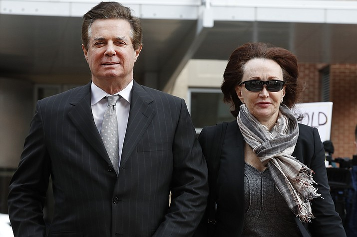In this March 8, 2018, file photo, Paul Manafort, left, President Donald Trump's former campaign chairman, walks with this wife Kathleen Manafort, as they arrive at the Alexandria Federal Courthouse in Alexandria, Va. Jury selection is set to begin in the trial of President Donald Trump's former campaign chairman. (AP Photo/Jacquelyn Martin, File)