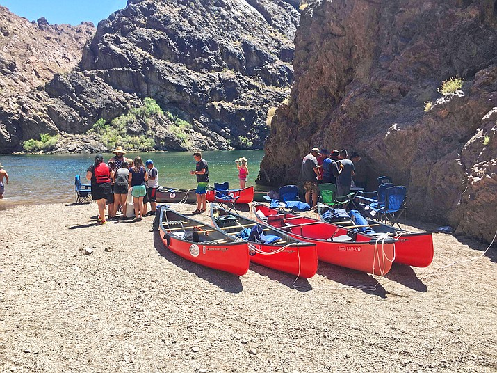 Ash Fork eighth graders and several teachers prepare to launch canoes for a three-day, two-night trip up the Colorado River at Black Canyon this summer.