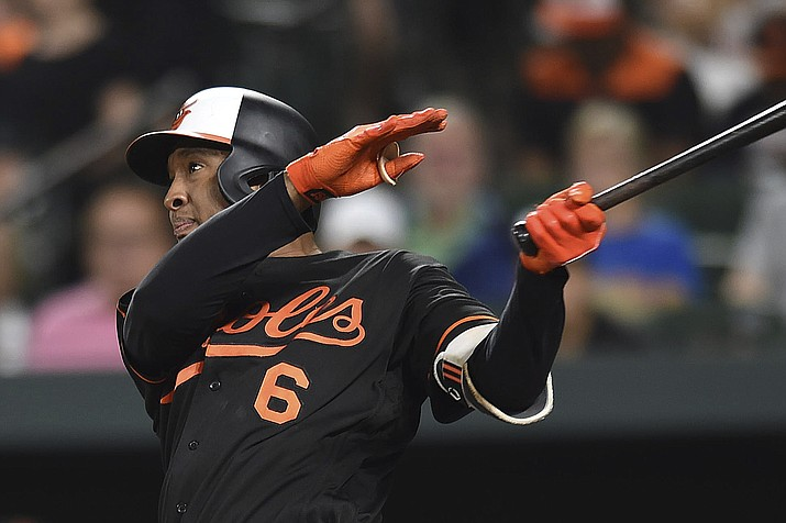 Baltimore Orioles' Jonathan Schoop follows through on a solo home run against the Tampa Bay Rays in the fifth inning of a baseball game, Friday, July 27, 2018, in Baltimore. (Gail Burton/AP, file)