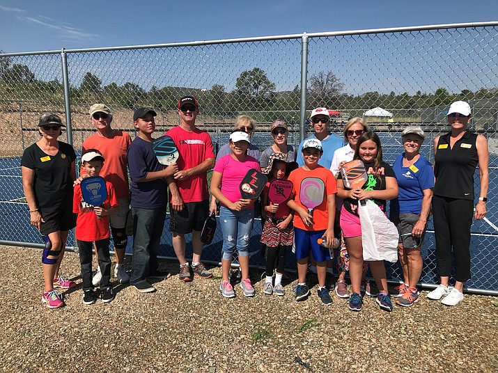 Members of Yavapai Big Brothers Big Sisters and the Prescott Pickleball Association pose for a photo Saturday, July 28, 2018, in Prescott. (Billie Orr/Courtesy)