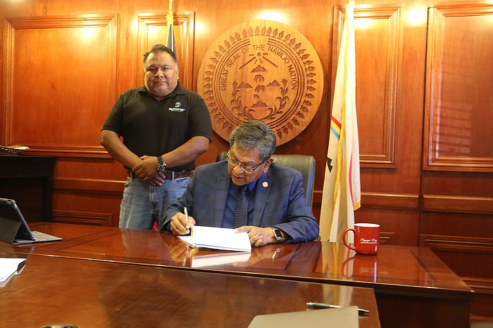 Navajo President Russell Begaye signs a contract July 26 to install solar power for 44 Navajo homes. (Office of the President and Vice President)