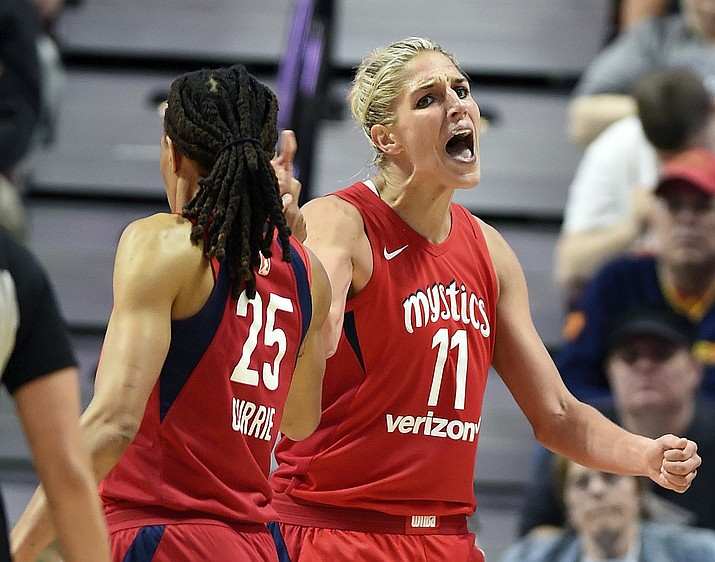 "In this June 13, 2018, file photo, Washington Mystics forward Elena Delle Donne (11) celebrates with teammate Monique Currie (25) after being fouled by Connecticut Sun forward Chiney Ogwumike during the second half of a WNBA basketball game in Uncasville, Conn. All 12 teams will play eight or nine games over the next few weeks setting up for one of the most exciting final few weeks of the regular season in league history with only four losses separating second place Atlanta from ninth-place Las Vegas. ""It's going to be a wild last few weeks,"" said Elena Delle Donne. (Sean D. Elliot/The Day via AP, File)"