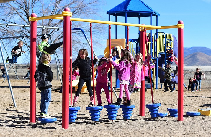 First-grade students at Coyote Springs Elementary School in Prescott Valley hit the playground for their morning recess, February 1, 2017. A new law that kicks in Friday gives children in kindergarten through third grade at least two recess periods a day. (Les Stukenberg/Courier)
