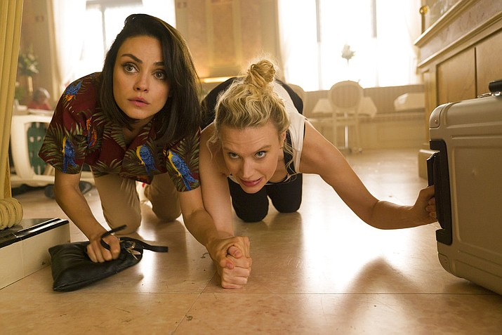 "This image released by Lionsgate shows Kate McKinnon, right, and Mila Kunis in a scene from ""The Spy Who Dumped Me."" (Hopper Stone/Lionsgate via AP)"