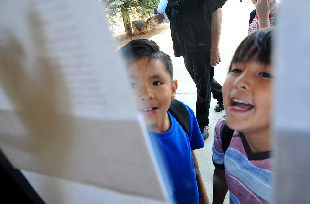 Second grader Elias Nehoitewa and third grader Matthias Hayah look at whose in their classes at Abia Judd Elementary School Thursday, August 2, 2018 as Prescott Unified School District starts the 2018-19 school year. (Les Stukenberg/Courier)