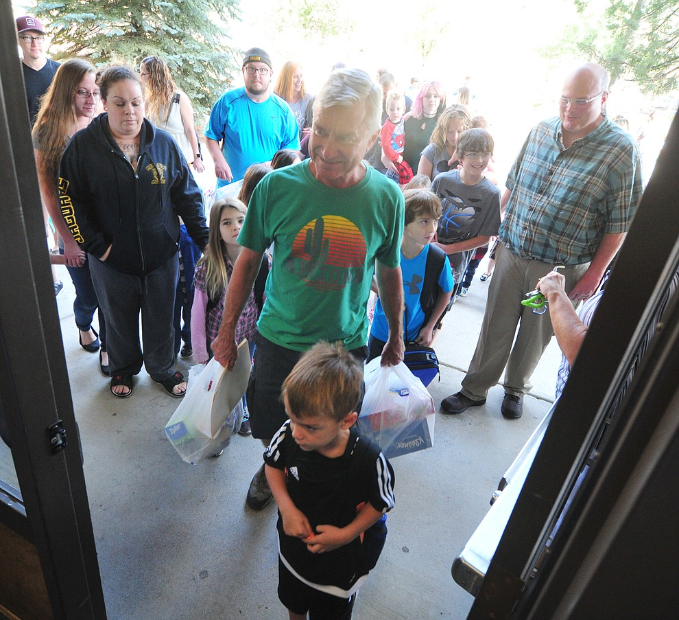 Parents and students head into the school at Abia Judd Elementary School Thursday, August 2, 2018 as Prescott Unified School District starts the 2018-19 school year. (Les Stukenberg/Courier)