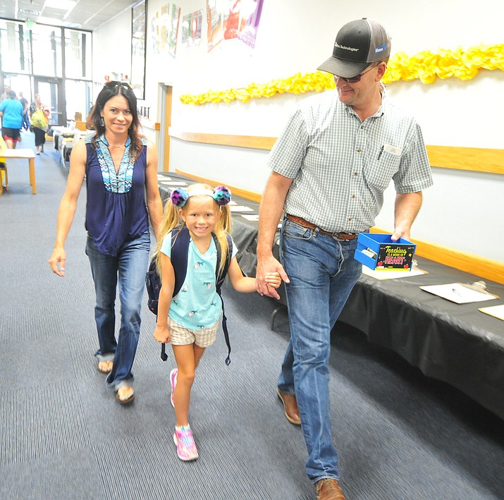 Rick and Sarah Kieckhefer walk second-grader Kodi to class at Abia Judd Elementary School Thursday, Aug. 2, 2018, as Prescott Unified School District starts the 2018-19 school year. (Les Stukenberg/Courier)