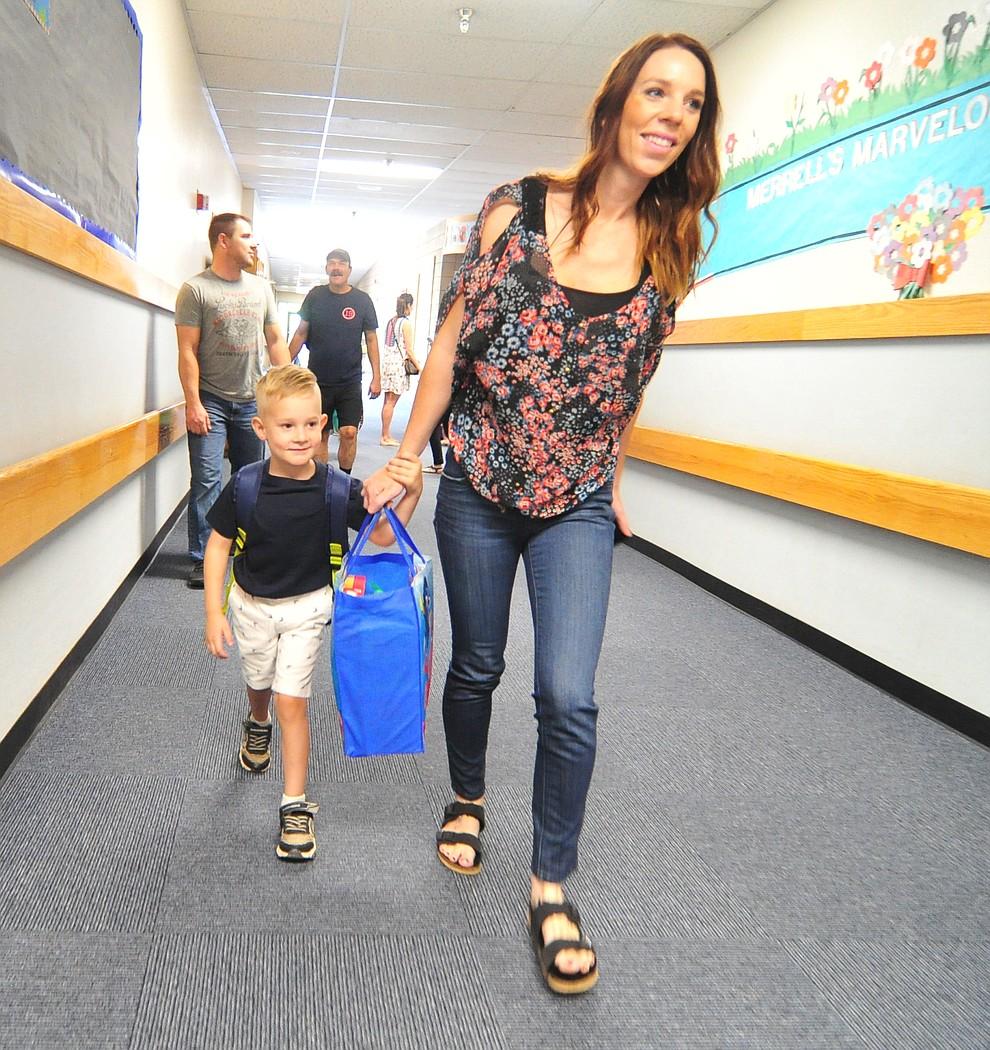 Nicole Baldwin walks Wyatt to his first day of kindergarten at Abia Judd Elementary School Thursday, August 2, 2018 as Prescott Unified School District starts the 2018-19 school year. (Les Stukenberg/Courier)