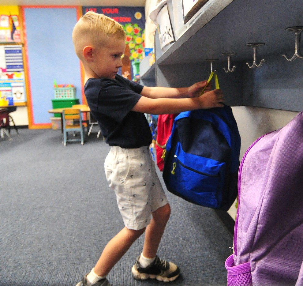 Kindergartener Wyatt Baldwin puts backpack away at Abia Judd Elementary School Thursday, August 2, 2018 as Prescott Unified School District starts the 2018-19 school year. (Les Stukenberg/Courier)