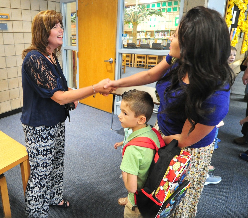 Principal Stephanie Hillig greets parents and students at Abia Judd Elementary School Thursday, August 2, 2018 as Prescott Unified School District starts the 2018-19 school year. (Les Stukenberg/Courier)