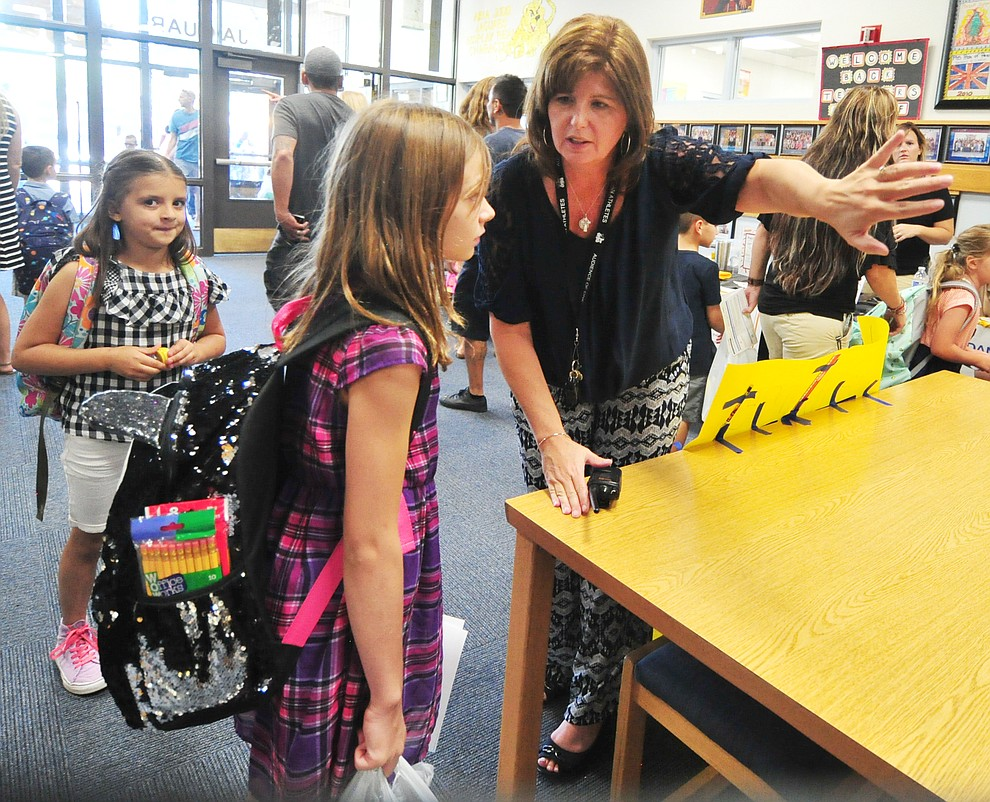 Principal Stephanie Hillig directs fourth grader Shealee Reynolds to her class at Abia Judd Elementary School Thursday, August 2, 2018 as Prescott Unified School District starts the 2018-19 school year. (Les Stukenberg/Courier)