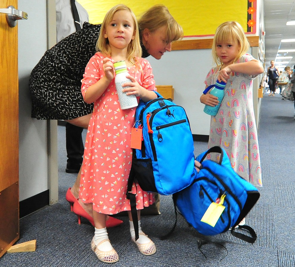 Meghan Anderson says goodbye to kindergarten twins Karlee and Reagan at Abia Judd Elementary School Thursday, August 2, 2018 as Prescott Unified School District starts the 2018-19 school year. (Les Stukenberg/Courier)
