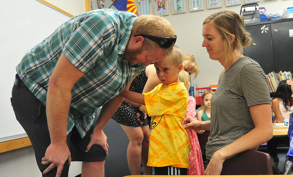 Clayton Donaldson isn't quite sure he wants to have Kelly Donaldson and Lucy Taylor to leave his kindergarten classroom at Abia Judd Elementary School Thursday, August 2, 2018 as Prescott Unified School District starts the 2018-19 school year. (Les Stukenberg/Courier)