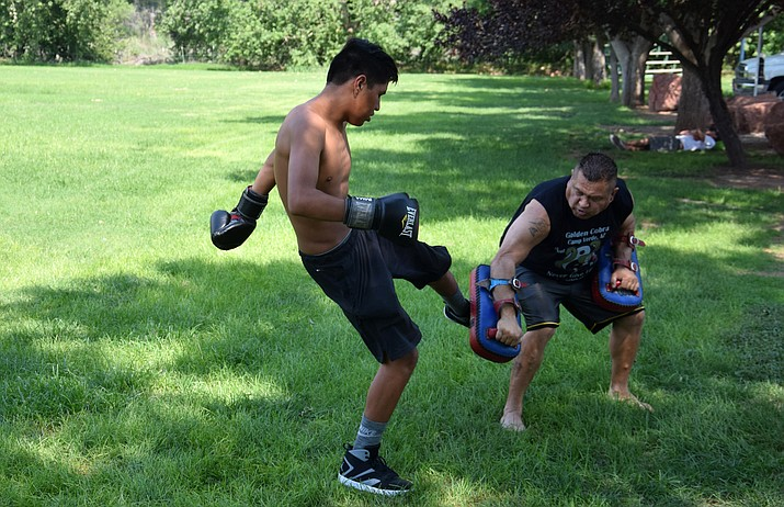 Adam Hines (left) trains with Richard Williams at Riverfront Park in Cottonwood on Tuesday. VVN/James Kelley