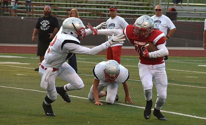 Mingus Union's Alex Nelson stiff arms a defender during last year's Red and Gray Scrimmage. VVN/James Kelley