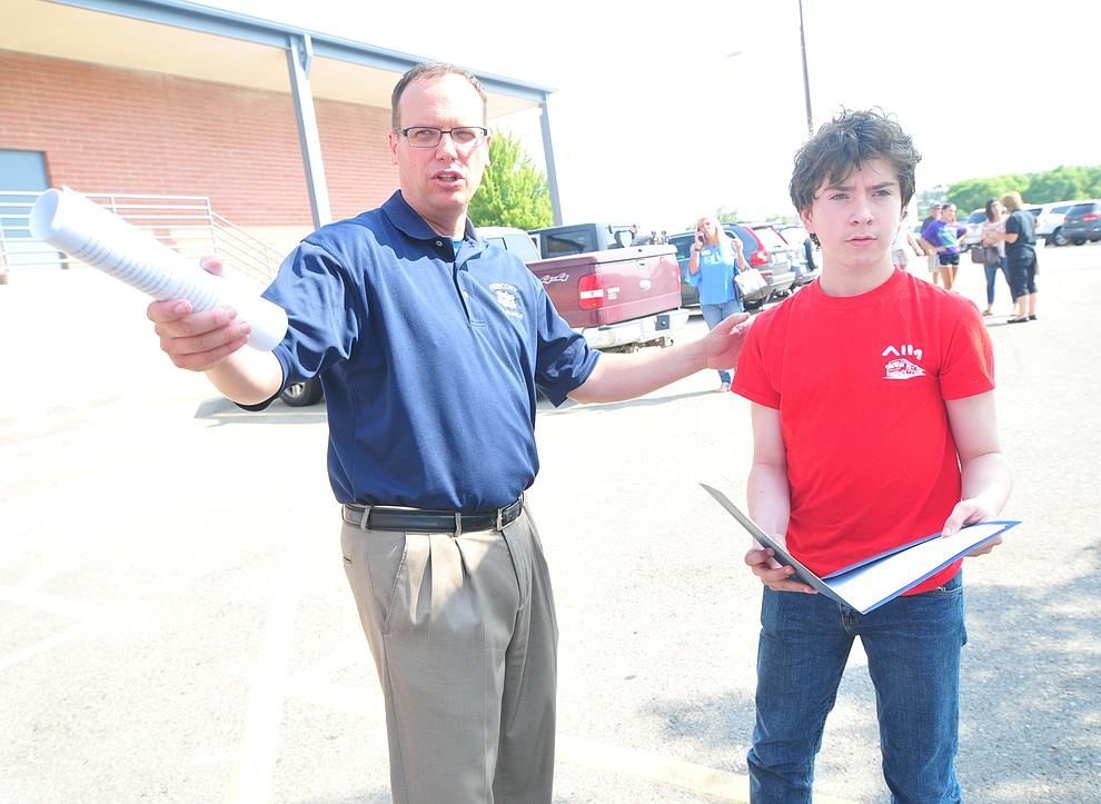 Principal Mark Goligoski directs Matthew Stritmatter to the Ruth Street Theatre during freshman orientation at Prescott High School Tuesday, July 31, 2018. (Les Stukenberg/Courier)