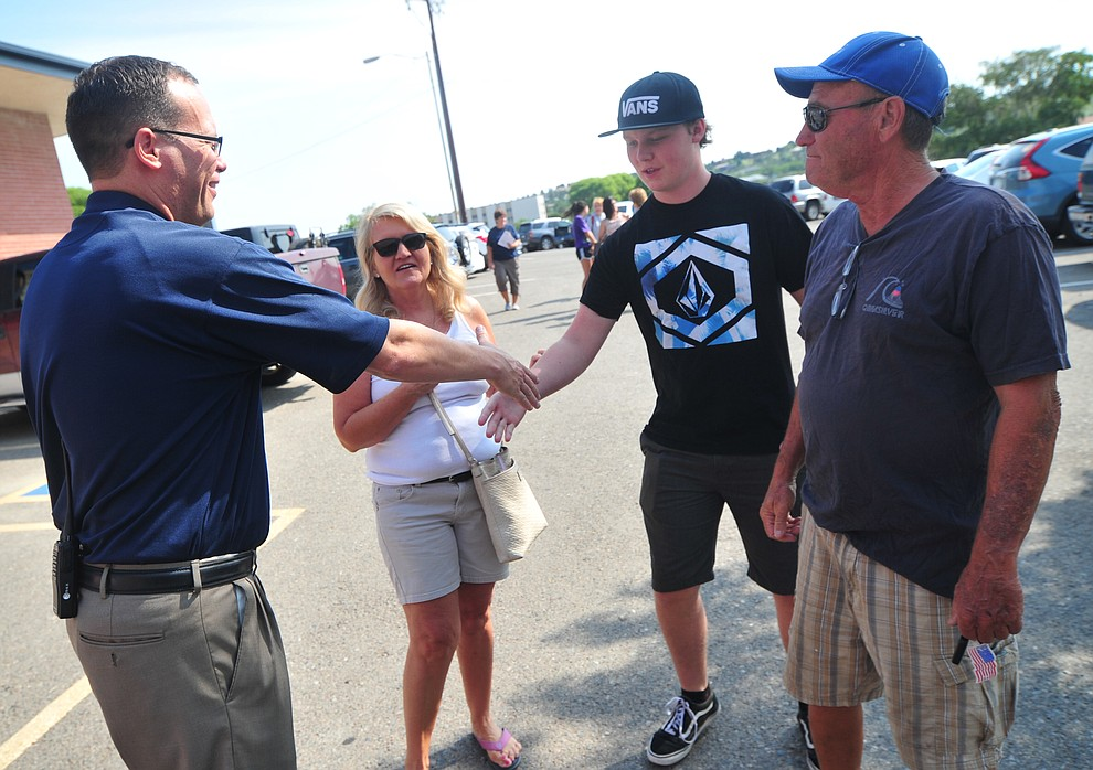 Principal Mark Goligoski greets Jacob Uren and his grandparents Pam and Tom Shipley during freshman orientation at Prescott High School Tuesday, July 31, 2018. (Les Stukenberg/Courier)