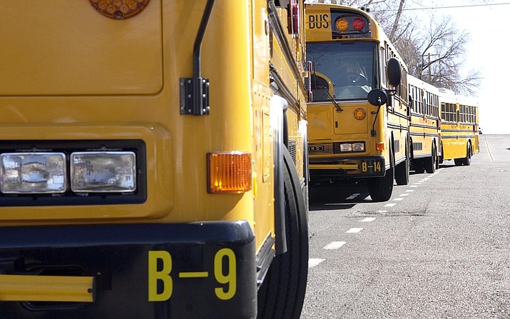 Prescott Unified School District buses wait for students after school in this undated photo. (Courier, file)