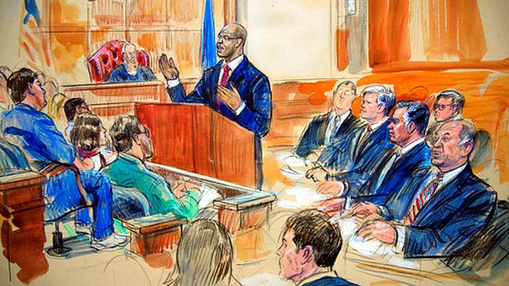 This courtroom sketch depicts Paul Manafort, seated right row second from right, together with his lawyers, the jury, seated left, and the U.S. District Court Judge T.S. Ellis III, back center, listening to Assistant U.S. Attorney Uzo Asonye, standing, during opening arguments in the trial of President Donald Trump's former campaign chairman Manafort's on tax evasion and bank fraud charges. (Sketch by Dana Verkouteren)