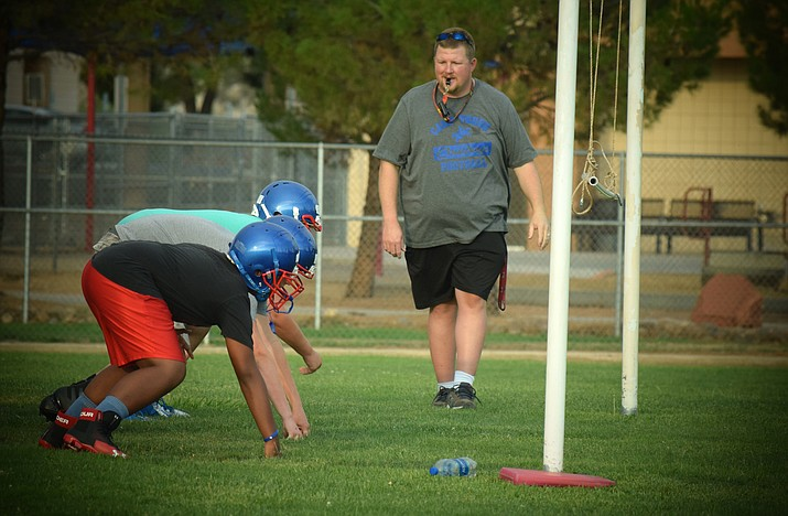 Camp Verde head coach Rick Walsworth coaches the Cowboy linemen during practice on Tuesday. VVN/James Kelley