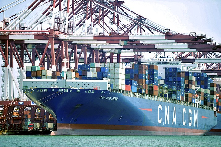In this July 6, 2018, file photo, a container ship is docked at a port in Qingdao, in eastern China's Shandong Province. The Trump administration is proposing raising planned taxes on $200 billion in Chinese imports to 25 percent from 10 percent, turning up the pressure on Beijing in a trade war between the world's two biggest economies. (Chinatopix via AP, File)