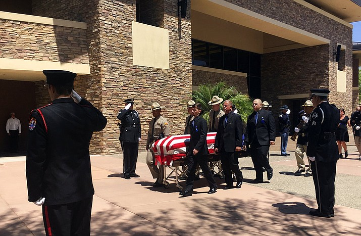 Pallbearers guide the casket of Arizona state trooper Tyler Edenhofer in Peoria, Ariz., on Friday, Aug. 3, 2018. The 24-year-old trooper was killed July 25 during a struggle with a suspect along a highway in suburban Phoenix. (AP Photo/Terry Tang)